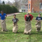 Maxine, Luc, Sam and Liam racing in sacks