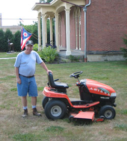 Terry Hobbs volunteers to mow the lawn of the Oberlin Heritage Center