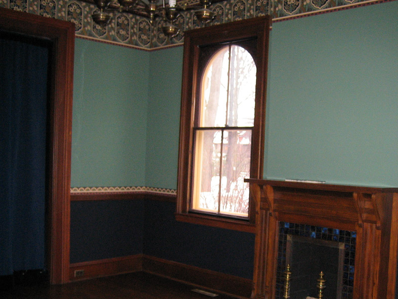 Finished walls of the Monroe House parlor, complete with new paint, wallpaper boarders, and picture and chair rails.